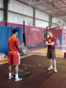 Ben Hale (on the right) resting before Adam tests him on his vertical jump.